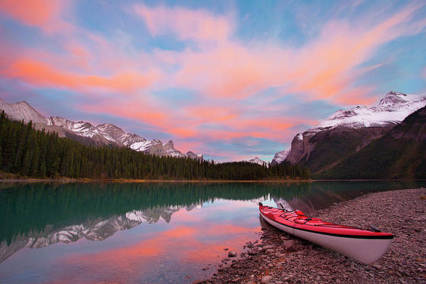 Waters Edge Photograph - Kayak On Shore Of Maligne Lake by Danita Delimont