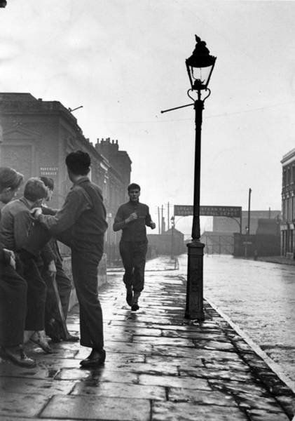 English Culture Photograph - Keen Jogger by John Chillingworth