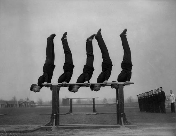 Upside Down Photograph - Keeping Fit by Fox Photos