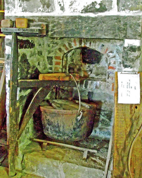 Wall Art - Photograph - Kettle For Making Soap Inside Rowboat House At St. Laurent Maritime Park, Ile D'orleans, Quebec by Ruth Hager