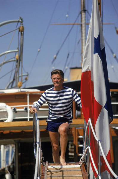 Yacht Photograph - Kirk Douglas by Slim Aarons