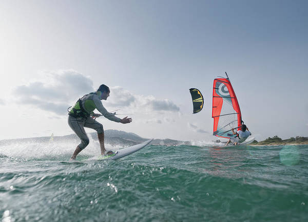 Adult Male Photograph - Kitesurfer And Windsurfer Along The by Ben Welsh / Design Pics