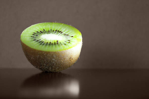 Healthy Lifestyle Photograph - Kiwi Fruit Cut In Half by By Felix Schmidt