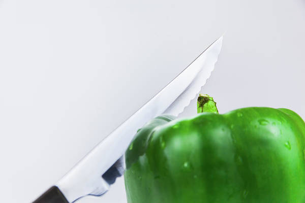 Photograph - Knife And Green Bell Pepper by Jeanette Fellows
