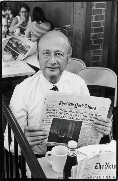 Newspaper Photograph - Koch Reads About Blackout by Fred W. McDarrah