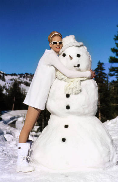 Dolce Wall Art - Photograph - Krister Mcmenamy Wearing White By A Snowman by Arthur Elgort