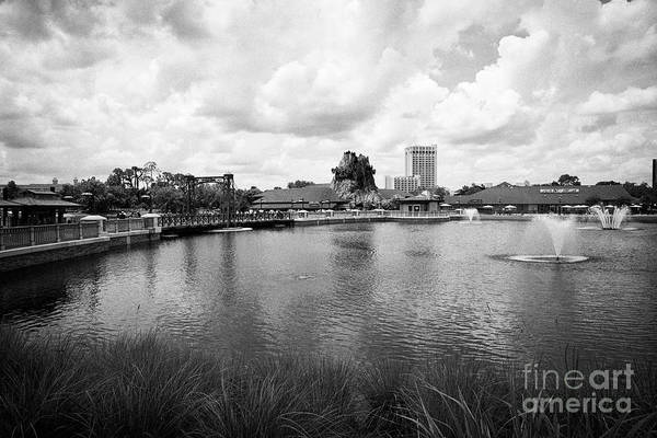 Wall Art - Photograph - lake at disney springs outdoor shopping and dining area orlando florida USA United States of America by Joe Fox