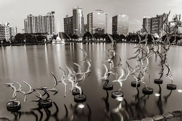 Photograph - Lake Eola Take Flight And Orlando Skyline - Sepia by Gregory Ballos