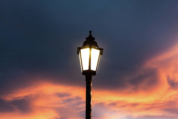 Photograph - Lantern At Sunset by Jeanette Fellows