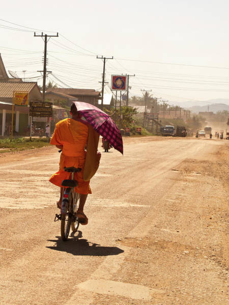 Dust Photograph - Laos, Vang Vien, Monk Riding Bike With by Win-initiative