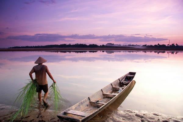 Wall Art - Photograph - Laotian Man Walking Into Calm River by Matthew Micah Wright