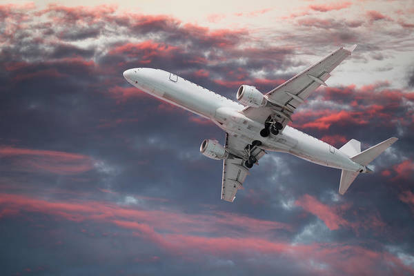 Wall Art - Photograph - Large Passenger Airplane Flying In A by Buzbuzzer