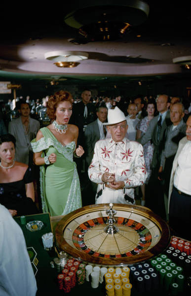 Customer Photograph - Las Vegas - Customers Rolling Dice At by Loomis Dean