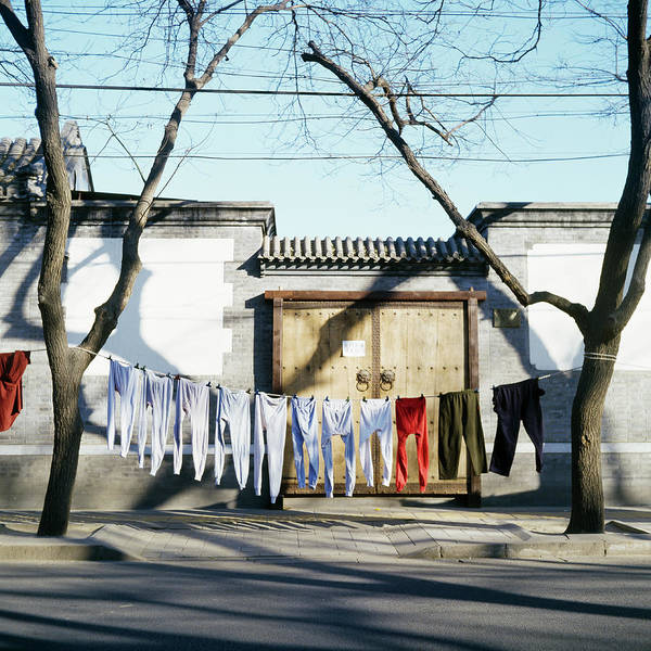 Jason Day Photograph - Laundry Drying On Clotheslines In Street by Jason Hosking