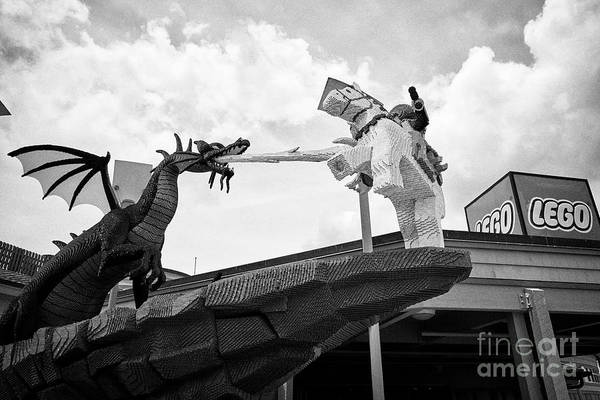 Wall Art - Photograph - lego george and the dragon outside the lego store at disney springs orlando florida USA United State by Joe Fox