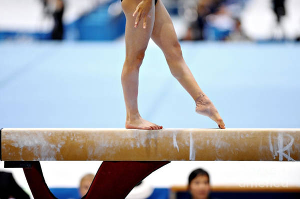 Championship Photograph - Legs Of A Gymnast Are Seen During An by Roibu
