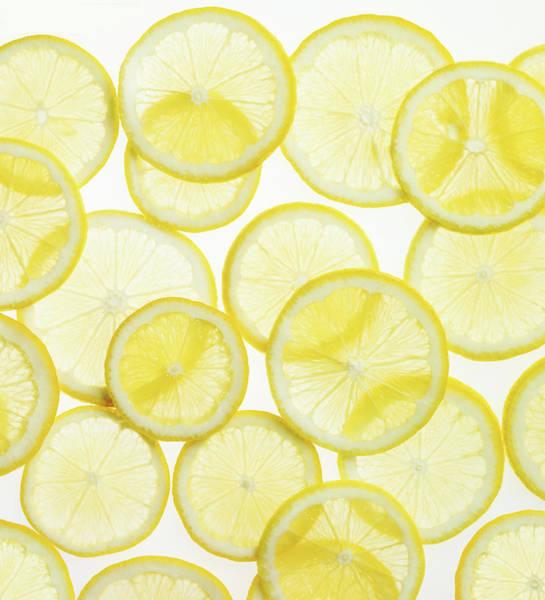 Lemon Photograph - Lemon Slices Arranged In Pattern by Lauren Burke