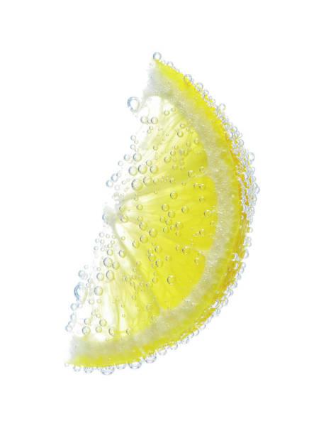 Lemon Photograph - Lemon Wedge With Bubbles by Chris Stein