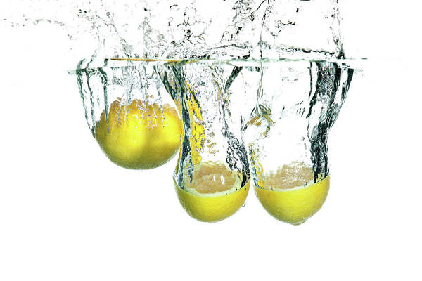 Cut Out Photograph - Lemons Falling In Water Isolated On by Amriphoto