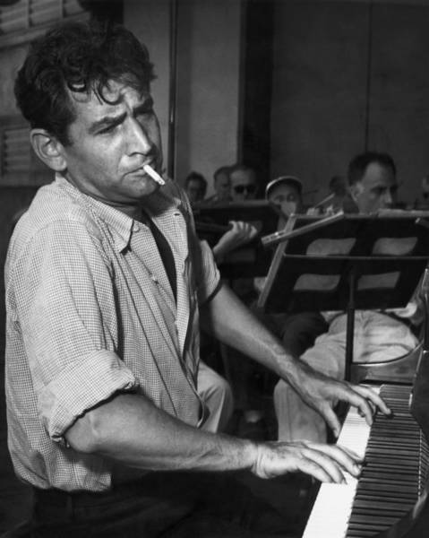 Leonard Bernstein Smoking At Piano Art Print by Bettmann