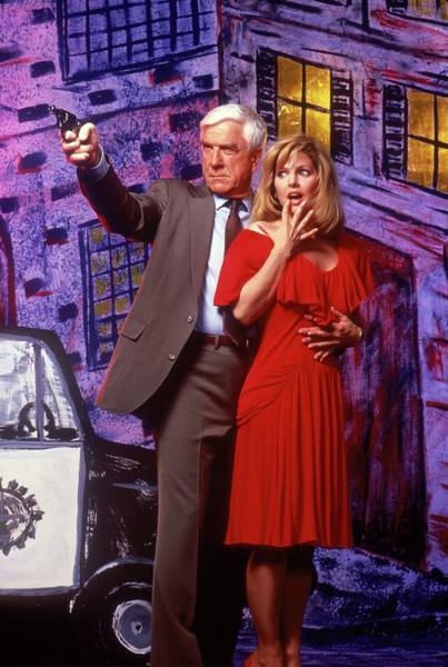 Leslie Nielsen Wall Art - Photograph - Leslie Nielsen And Priscilla Presley In The Naked Gun From The Files Of Police Squad -1988-. by Album