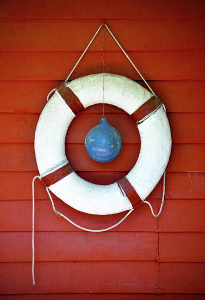 Hanging Photograph - Life Buoy Hanging On Wall by The Rich Earthy Tones Of Terracotta