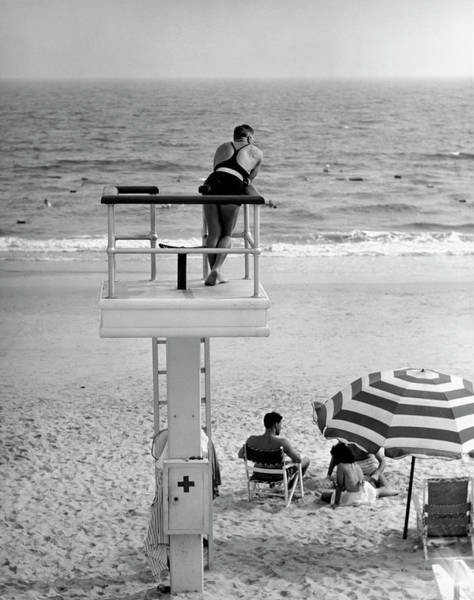 People Watching Photograph - Life-guard Looking Over Water by George Marks