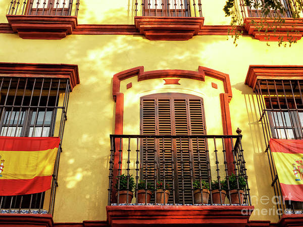 Photograph - Light Falls On The Building In Seville by John Rizzuto