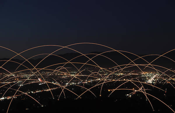 Capitalism Wall Art - Photograph - Light Trails Over City by Paul Taylor
