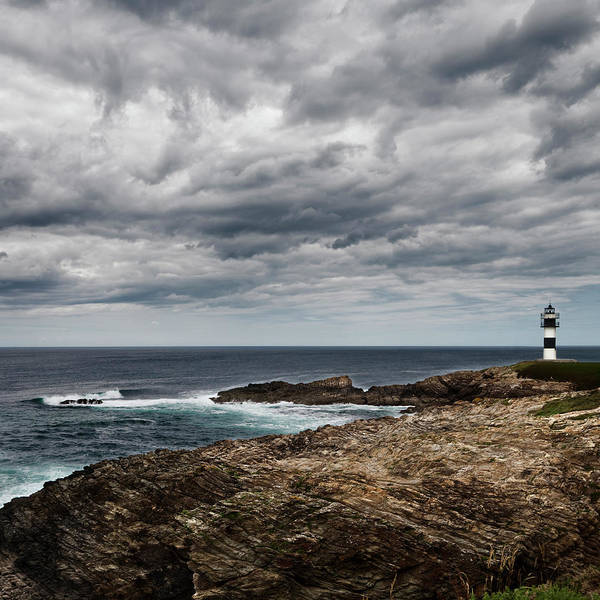 Galicia Photograph - Lighthouse At Isla Pancha by Julio Lopez Saguar