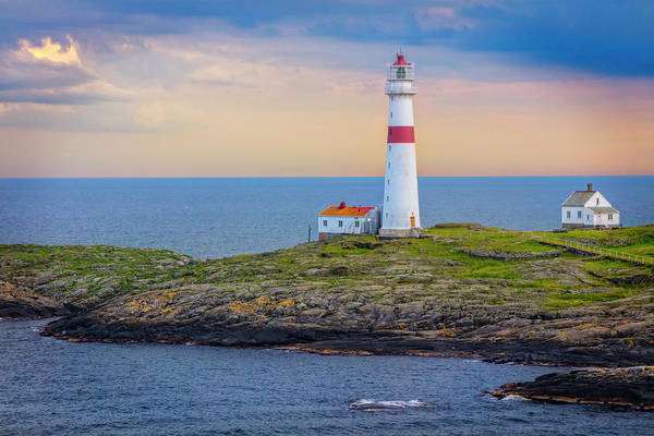 Photograph - Lighthouse In The Sunset Light by Debra and Dave Vanderlaan