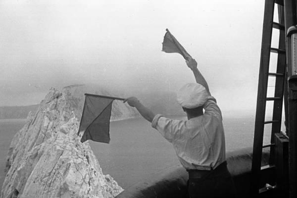 Human Limb Photograph - Lighthouse Semaphore by Kurt Hutton