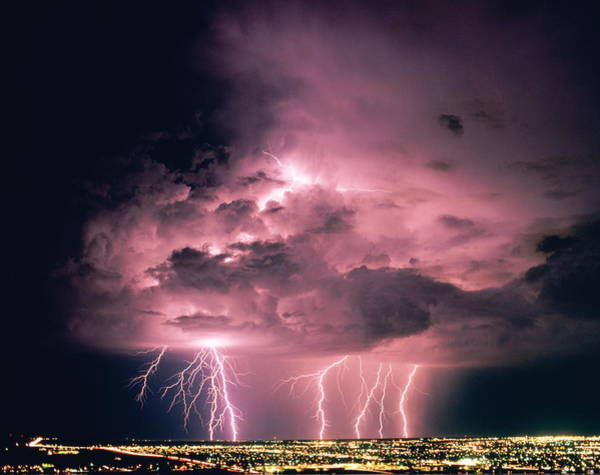 Threat Photograph - Lightning Above City Skyline At Night by Ralph Wetmore