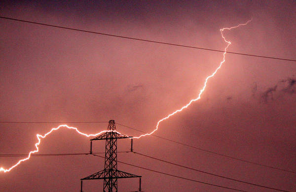 Electricity Generation Photograph - Lightning Hitting An Electricity Pylon by Peter Lawson