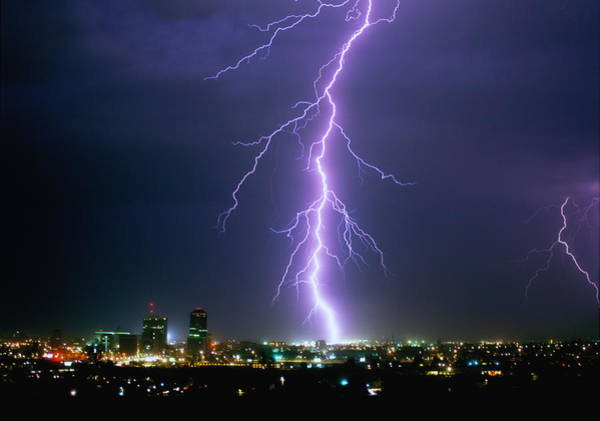 Tucson Photograph - Lightning Illuminating Cityscape At by Ralph Wetmore