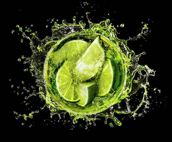 Cocktail Photograph - Lime Splash Into Cocktail Glass by Stilllifephotographer