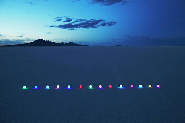 Wall Art - Photograph - Line Of Glowing Orbs In Desert At Dusk by Andy Ryan