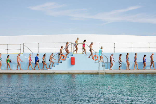 Adult Humor Photograph - Line Of Swimmers Walking Over Steps by Three Images