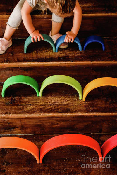 Photograph - Little Girl Playing With Waldorf Montessori Rainbow Of Various Colors  Concentrating On Difficult Task. by Joaquin Corbalan