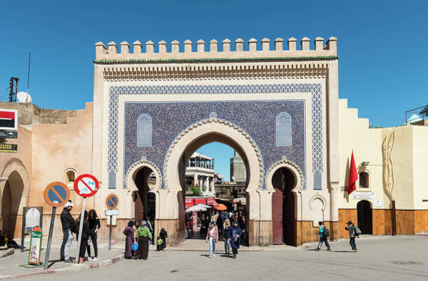 Wall Art - Photograph - Locals And Tourists In Front Of Bab Boujeloud Blue Gate Of Fes Minaret Of The Madrasa Madrasa Bou by imageBROKER - Moritz Wolf
