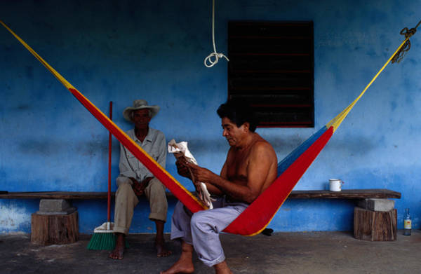 Adult Male Photograph - Locals Resting On The Porch In by Jeffrey Becom