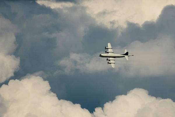Photograph - Lockheed P-3c Orion Flying Through The Clouds by Scott Lyons