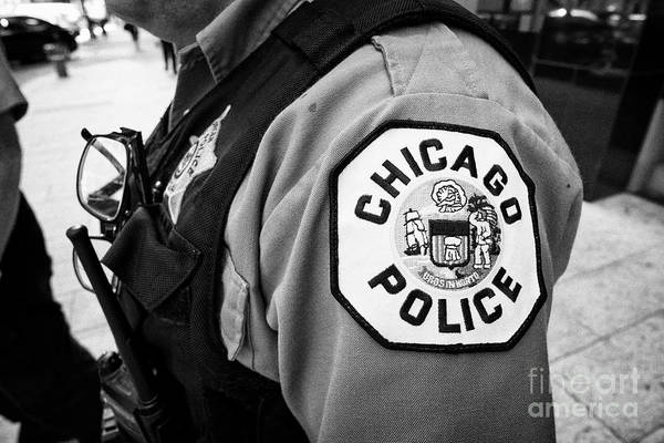 Wall Art - Photograph - logo of the chicago police on a police officers uniform downtown Chicago IL USA by Joe Fox