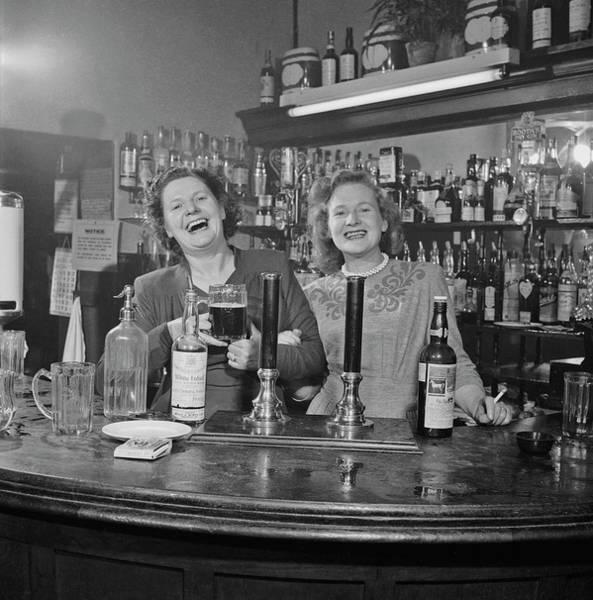1940 Photograph - London Barmaids by Slim Aarons