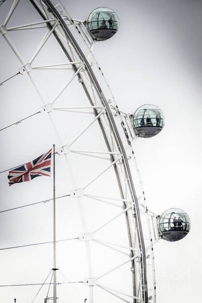 Photograph - London Eye And Union Jack by Arnaldo Tarsetti