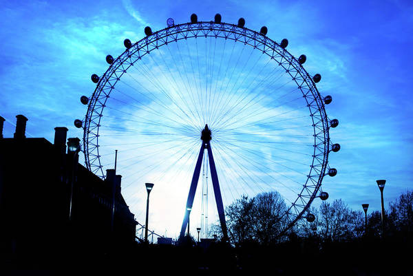 Silhouette Photograph - London Eye At Silhouette Against Blue by Sharon Vos-arnold