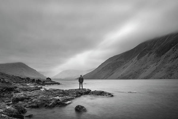 Wall Art - Photograph - Lone Man In Landscape Image Of Wast Water In Uk Lake District Du by Matthew Gibson