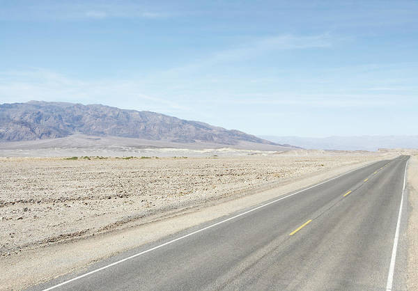 Arid Climate Wall Art - Photograph - Long Flat Road With Mountains by Thomas Northcut
