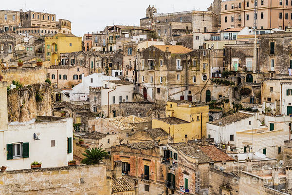 Photograph - Long Panoramic Views Of The Rocky Old Town Of Matera With Its St by Joaquin Corbalan