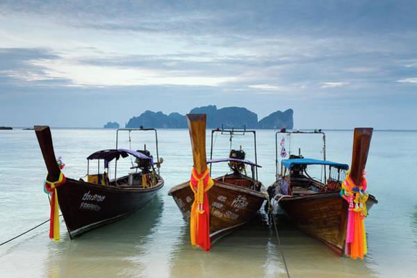 Phi Photograph - Long-tail Boats At Hat Yao Long Beach by Andrew Watson